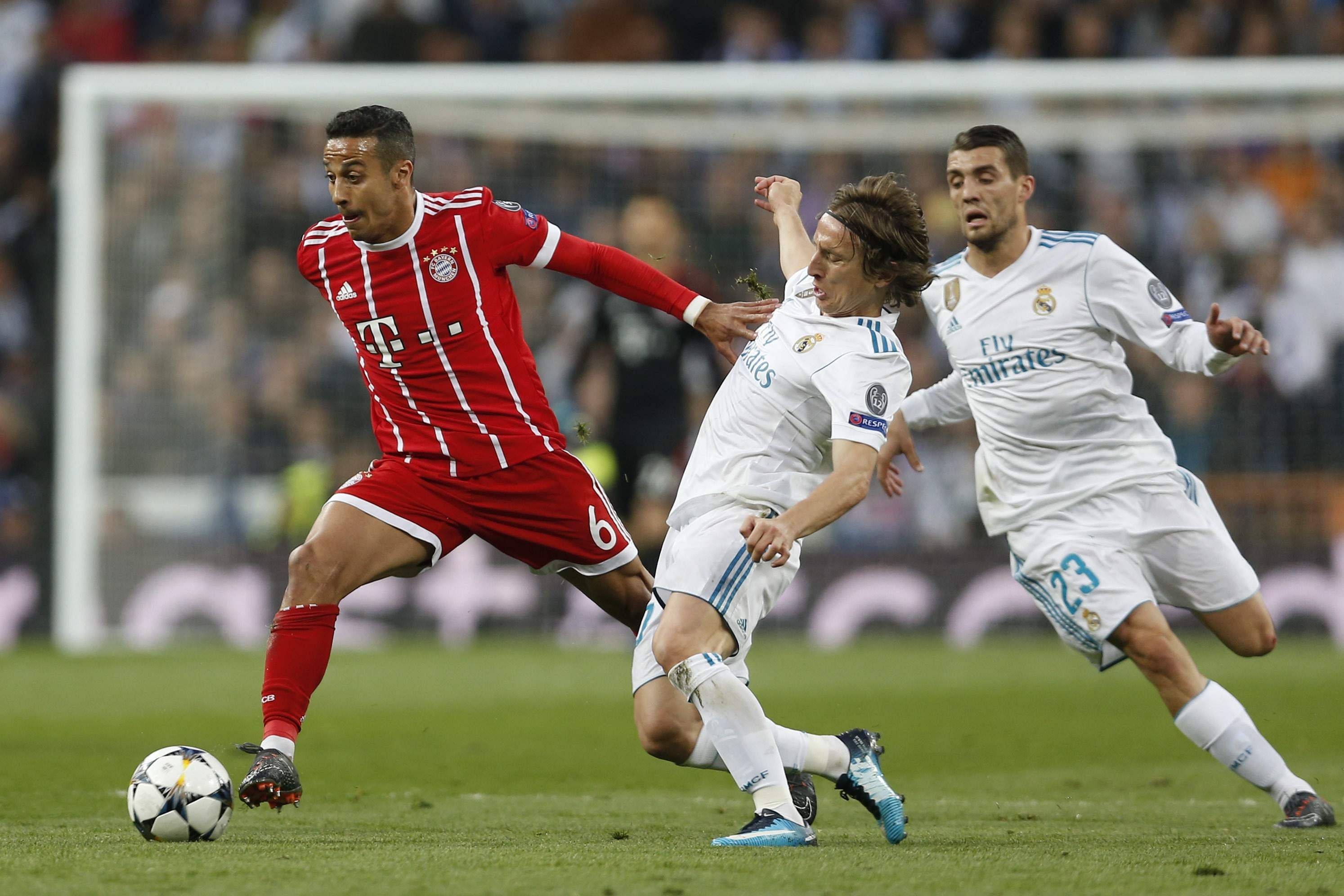 Bayern's Thiago, left, and Real Madrid's Luka Modric, Mateo Kovacic scuffle for the ball. (AP)