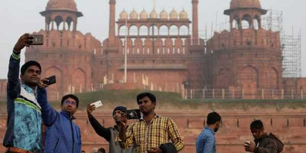 Domestic tourists take selfies in front of the historic Red Fort, one of the tourist destinations in the old quarters of Delhi, India, January 3, 2018. (Reuters)