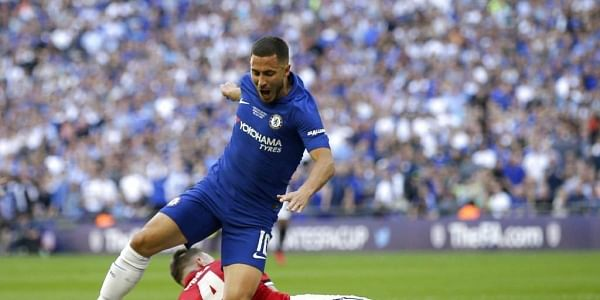 Manchester United's Phil Jones, on the ground, fouls Chelsea's Eden Hazard in the box to give away a penalty shot during the English FA Cup final soccer match between Chelsea and Manchester United at Wembley stadium in London. | AP