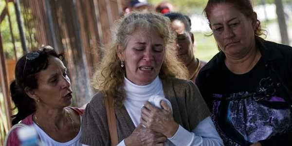 Grieving relatives of passengers who perished in Cuba's worst aviation disaster leave the morgue, in Havana, Cuba.   AP