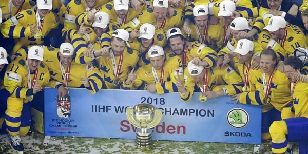 Sweden team pose with the trophy after their victory over Switzerland in the Ice Hockey World Championships final match at the Royal arena in Copenhagen, Denmark. | AP