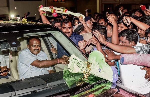 JD(S) Leader H D Kumaraswamy greets supporters after taking blessings of Seer Srisri Nirmalanandanatha Swamiji of Adichunchungiri Mutt in Bengaluru on Saturday. | PTI