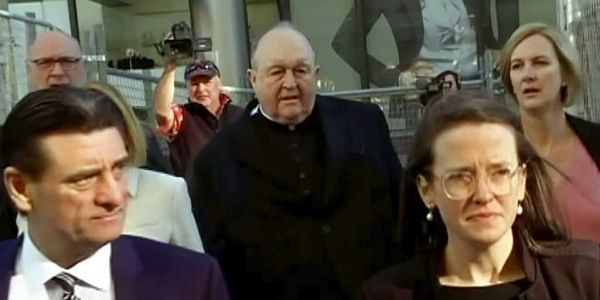 0 1 In this image made from video, Archbishop Philip Wilson, center, heads to Newcastle Local Court, north of Sydney, Australia. | AP
