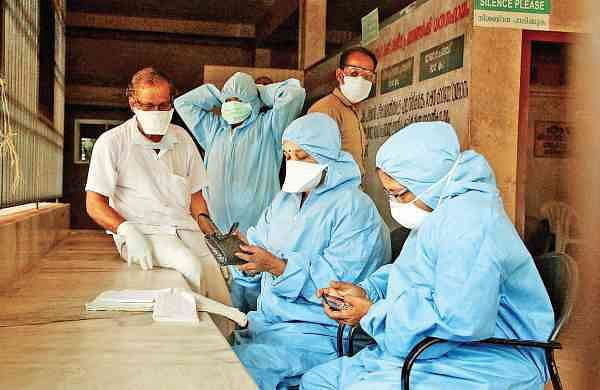 Nurses at the Government Taluk Hospital at Perambra in Kozhikode taking precautionary measures by wearing masks on Tuesday | T P Sooraj
