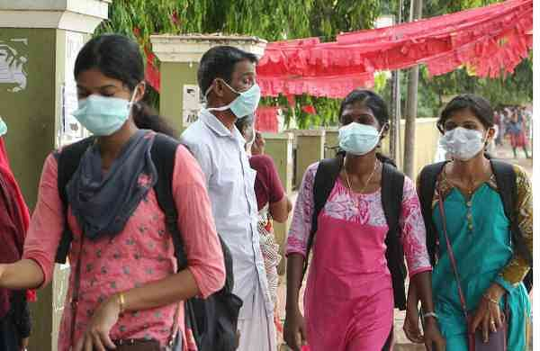 People wear face masks outside the medical College Hospital on Wednesday where several persons are under treatment for the Nipah Virus infection. (Express Photo   TP Sooraj)
