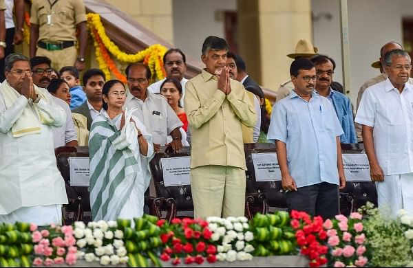 Andhra Pradesh CM N Chandrababu Naidu West Bengal Chief Minister Mamata Banerjee Delhi Chief Minister Arvind Kejriwal Kerala CM Pinarayi Vijayan and Karnataka former chief minister Congress leader Siddaramaiah during the swearing-in ceremony in Bengaluru on Wednesday.   PTI