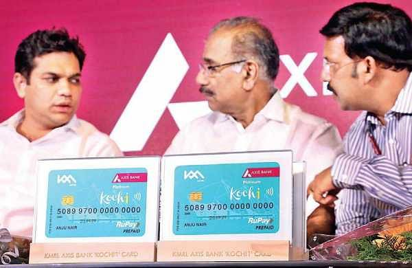 Transport Minister A K Saseendran, Hibi Eden MLA and Principal Secretary (Transport) K R Jyothilal during the signing of agreement between Kochi Metro Rail Ltd, Axis Bank and private bus operating companies in Kochi on  Thursday | Melton Antony