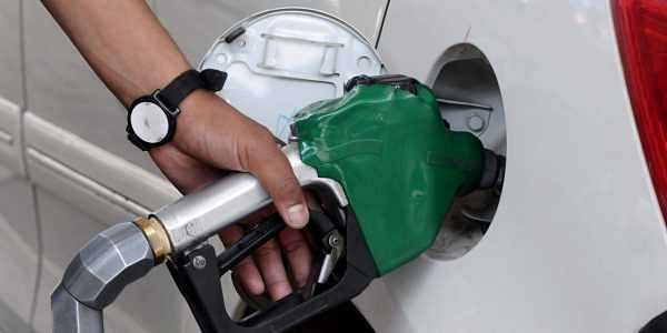 Petrol pump attendant filling the tank of a Car with petrol after hike in the prices of petrol and diesel  in New Delhi. (File | Express Photo)