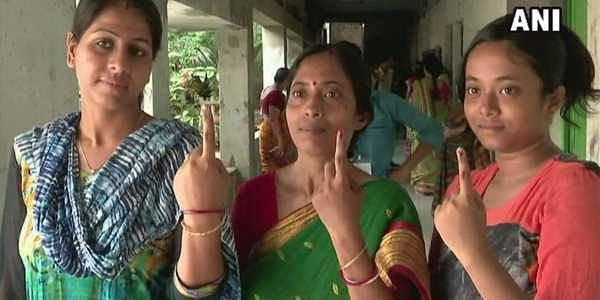 People outside a polling booth in Palghar