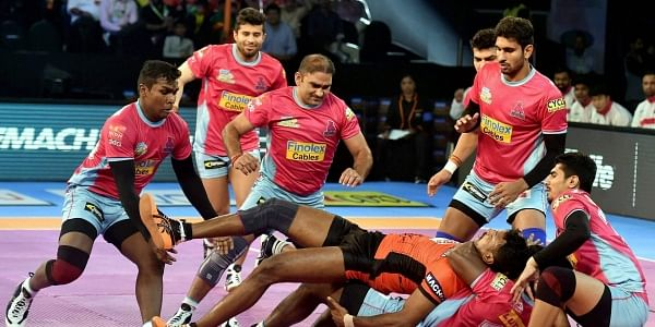U Mumba (orange) and Jaipur Pink Panthers (Pink) players in action during their Pro Kabaddi League match in Mumbai. | PTI