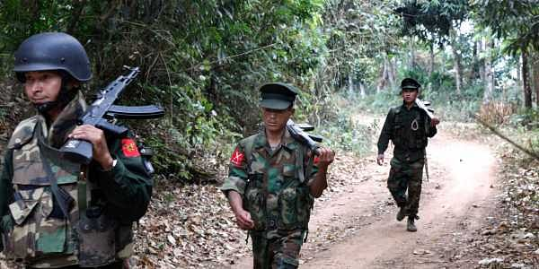 Kachin Independence Army fighters walk in a jungle path from Mu Du front line to Hpalap outpost in an area controlled by the rebels in northern Kachin state, Myanmar. (File | AP)