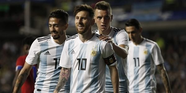 Argentina's Manuel Lanzini(L), Giovanni Lo Celso(SL), and Angel Di Maria (R) congratulate teammate Lionel Messi after his hat trick during a friendly against Haiti. | AP