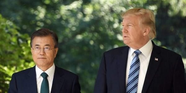 South Korean President Moon Jae-in (L) and US President Donald Trump. |File  AFP