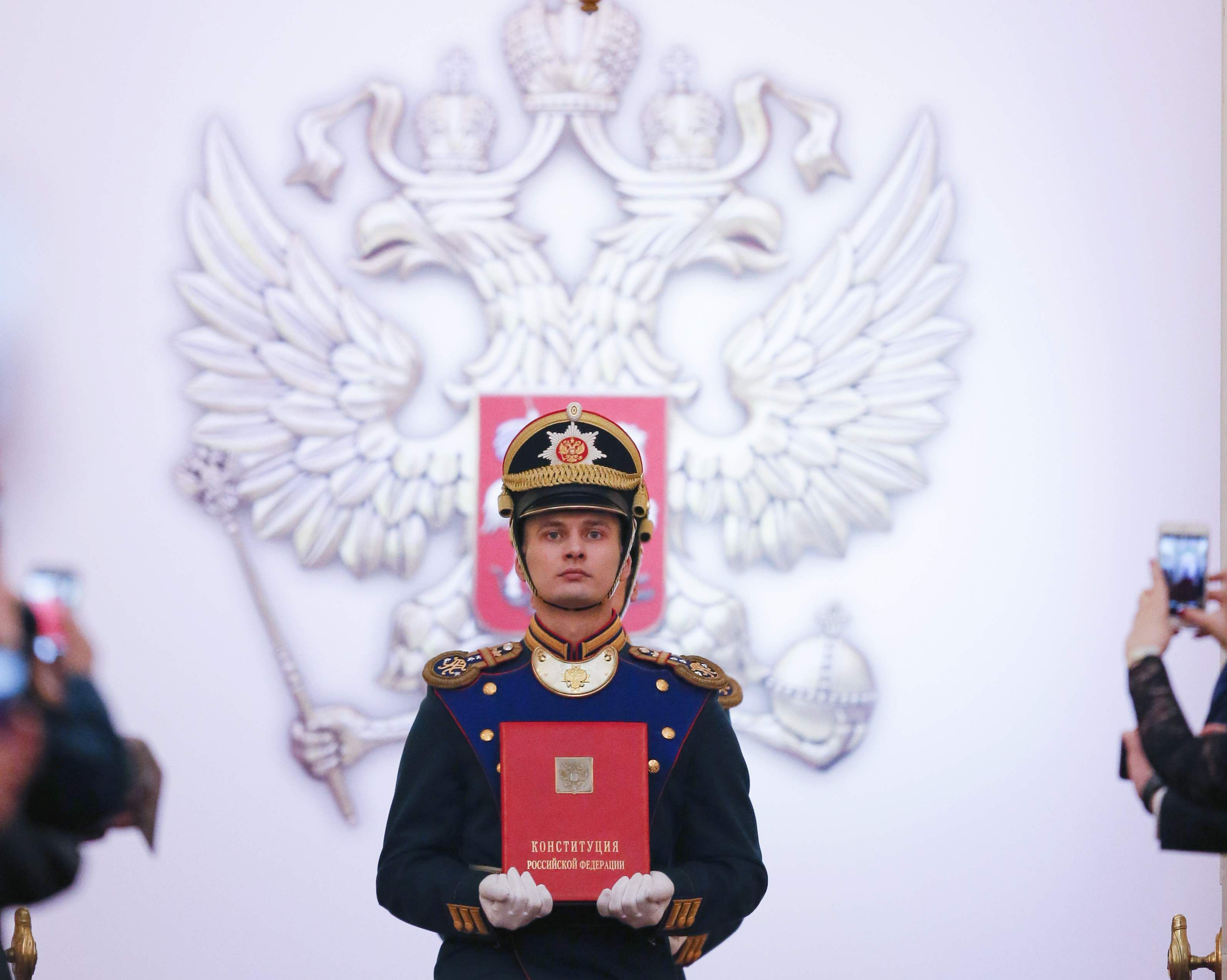 A Honour guard soldier carries the Constitution prior to Vladimir Putin's inauguration ceremony for a new term as Russia's president in the Grand Kremlin Palace in Moscow, Russia, Monday, May 7, 2018. (AP)