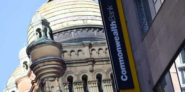 This file photo taken on May 1, 2018 shows a signage for Australia's biggest company, the Commonwealth Bank, is seen on a building in Sydney.  | AFP