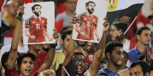 b97661032 Fans hold poster of Egyptian national football team player and Liverpool s  star striker Mohammed Salah during Egypt s final practice for the FIFA World  Cup ...
