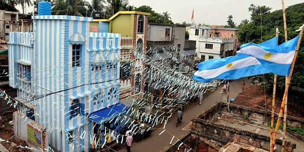 A view of tea-seller and die-hard Lionel Messi fan Shib Shankar Patra's three-storeyed apartment painted in blue-and-white ahead of FIFA World Cup 2018 to extend his support to Argentina in North 24 Parganas on Sunday June 10 2018. | PTI