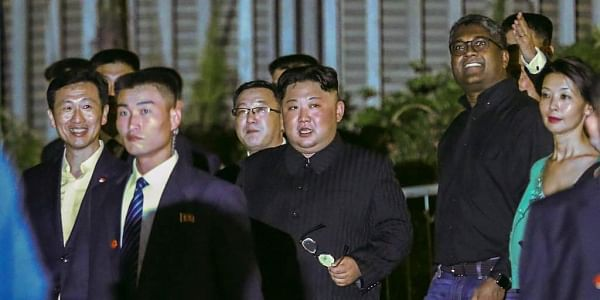 North Korea leader Kim Jong Un center is escorted by his security delegation as he visits Marina Bay in Singapore. | AP