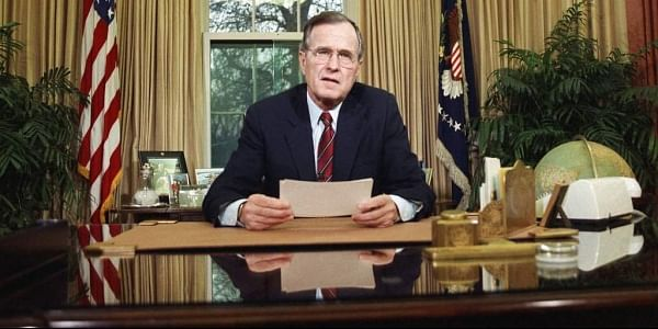 In this Dec. 20, 1989, file photo, President George H.W. Bush addresses the nation on television from the Oval Office in Washington as he explains his decision to deploy American troops to Panama. Bush is celebrating his 94th birthday in Maine. | AP