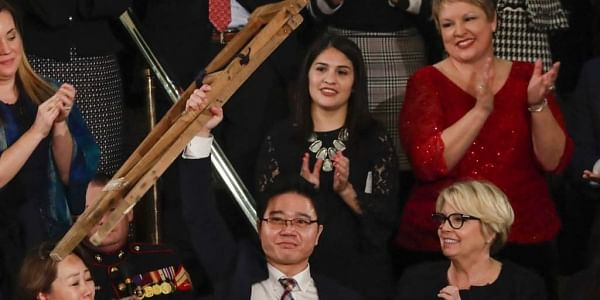 In this Jan. 30, 2018, file photo, Ji Seong-ho, a North Korean defector, holds up his crutches after his introduction by President Trump during the State of the Union address to a joint session of Congress on Capitol Hill in Washington. President Donald Trump had previously condemned the cruelty of North Korea's government, but after his historic summit on Tuesday with North Korean leader Kim Jong Un, Trump seemed to play down the severity of human rights violations in North Korea. | AP