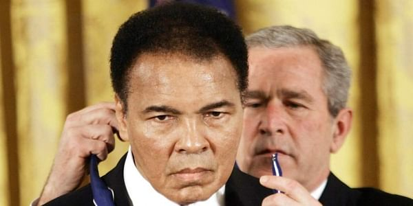 In this Nov. 2009 file photo, President Bush presents the Presidential Medal of Freedom to boxer Muhammad Ali in the East Room of the White House. | AP