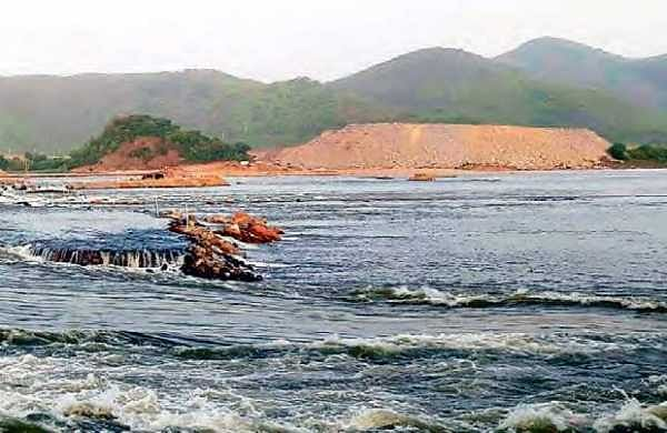 Water flows above the diaphragm wall; (below) Water rleased at Pattiseema | EXpress