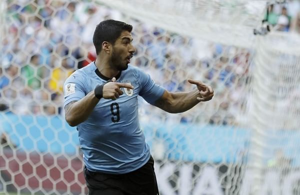 Uruguay's Luis Suarez celebrates scoring his side's first goal during the group A match against Saudi Arabia at the 2018 FIFA World Cup in Rostov Arena in Rostov-on-Don, Russia. (AP)