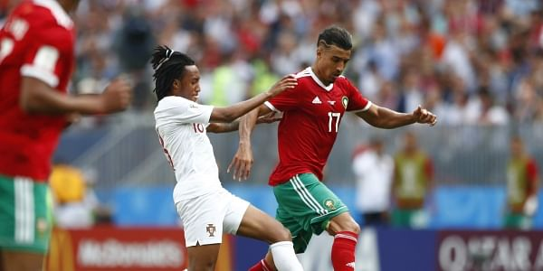 Portugal's Gelson Martins, center, challenges for the ball with Morocco's Nabil Dirar, right, during the group B match between Portugal and Morocco at the 2018 soccer World Cup in the Luzhniki Stadium in Moscow, Russia, Wednesday, June 20, 2018. | AP