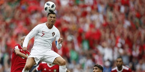 Portugal's Cristiano Ronaldo leaps up for a header during the group B match between Portugal and Morocco at the 2018 soccer World Cup in the Luzhniki Stadium in Moscow, Russia, Wednesday, June 20, 2018. | AP