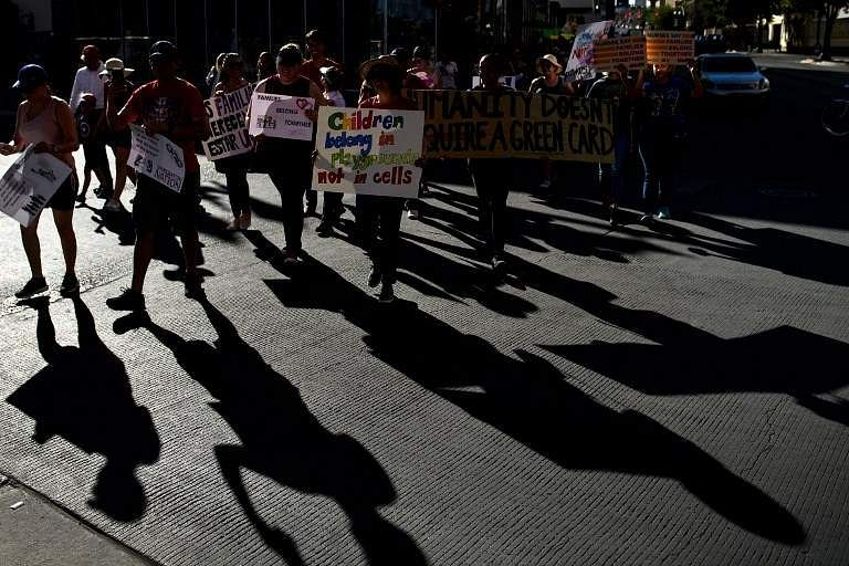 It also suggests the government intends to hold the families indefinitely by challenging an existing statute, the 1997 Flores Settlement, that places a 20-day limit on how long children, alone or with their parents, can be detained. That move could lead to new legal battles for the administration. IN PIC: People take part in a protest against US immigration policies outside the US embassy in Mexico City on June 21, 2018.| AFP