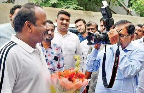 Deputy Chief Minister G Parameshwara clicks a picture of Bengaluru Mayor Sampath Raj before inspecting the multi-level car parking facility near Freedom Park on Thursday | Pushkar V
