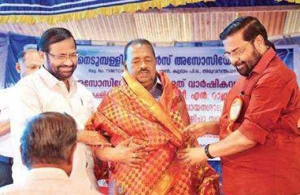 Kadakampally Surendran honouring  N Rajan for his contribution
