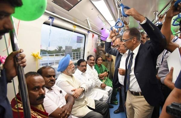 Chief Minister HD Kumaraswamy takes a ride with Union MoS Hardeep Singh Puri, DCM Parameshwara and KJ George in Bengaluru on Friday| Nagaraja Gadekal