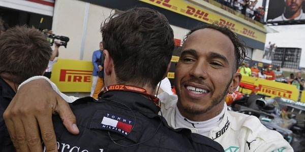 Hamilton cruises back to standings summit with France win