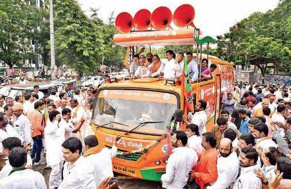 BJP Telangana president K Laxman waves to the crowd from the bus during the BJP Jana Chaitanya Yatra' in Hyderabad, on Saturday   express
