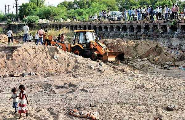 Revenue authorities excavating the Irukulla vagu, in Karimnagar on Saturday to find the mortal remains of four persons who were washed away in floods   EXPRESS