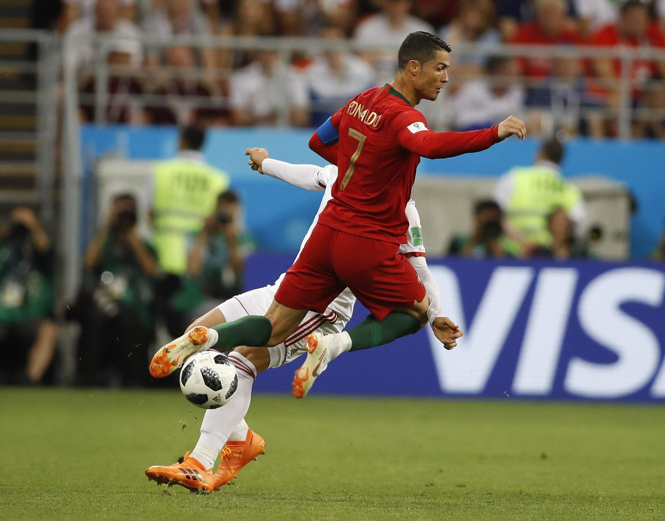Portugal's Cristiano Ronaldo, collides with Iran's Alireza Jahanbakhsh during the group B match between Iran and Portugal. (Photo | AP)