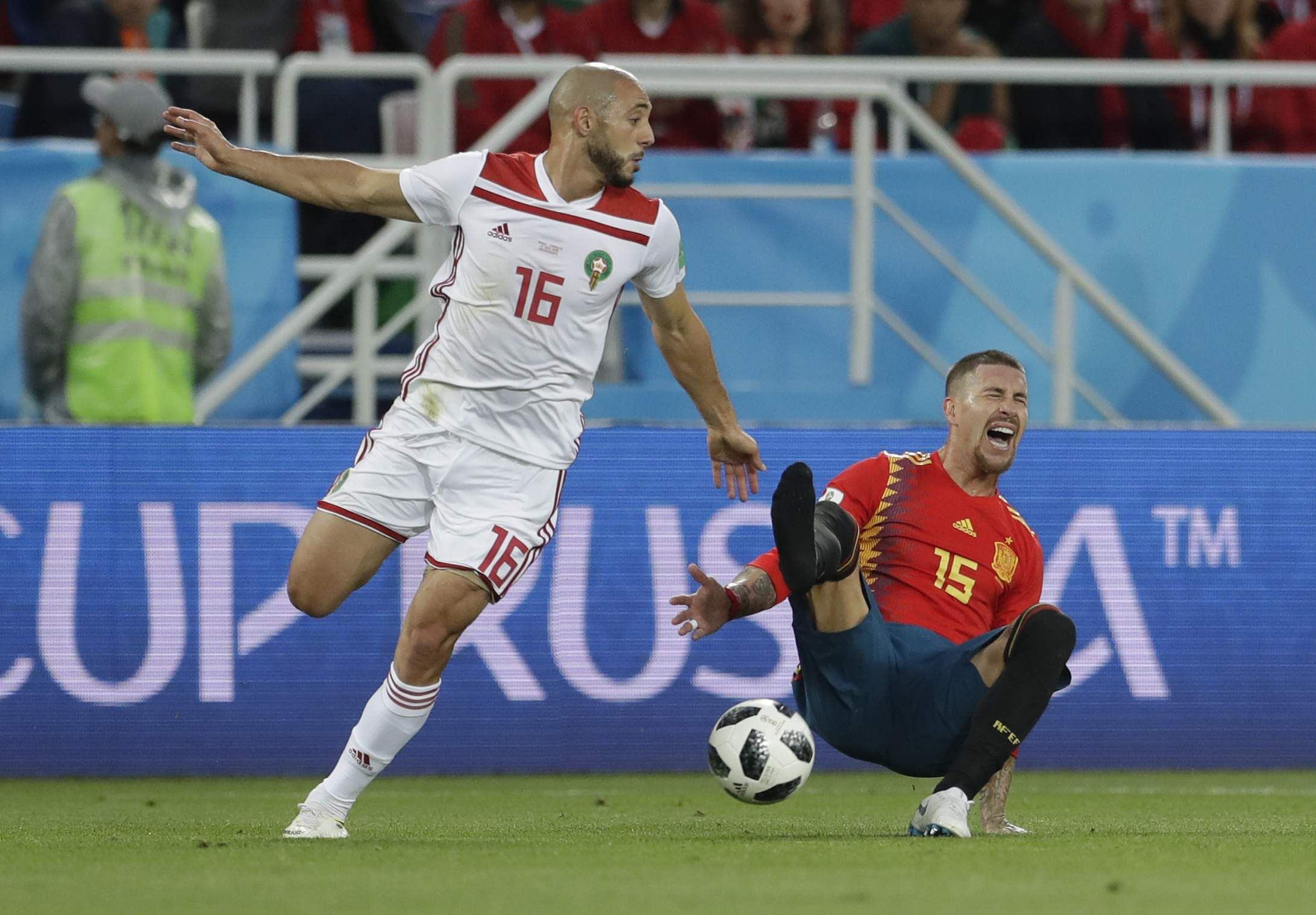 Spain's Sergio Ramos, right falls, losing his shoe after a tackle by Morocco's Noureddine Amrabat, left, during the group B match between Spain and Morocco at the 2018 FIFA World Cup at the Kaliningrad Stadium in Kaliningrad, Russia. (Photo | AP)