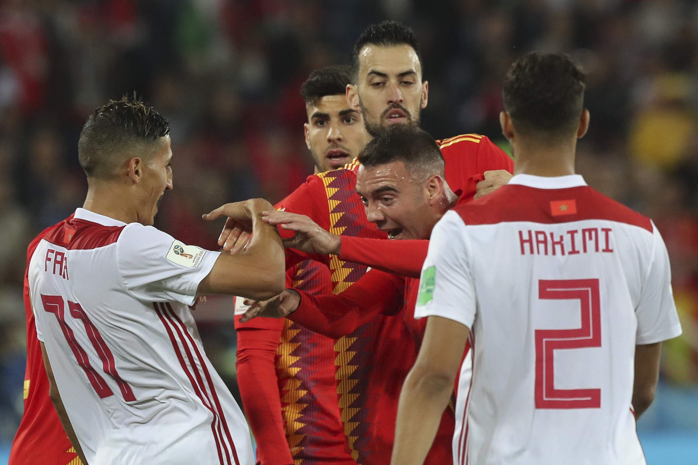 Spain's Iago Aspas, center, argues with Morocco's Faycal Fajr, left, during the group B match between Spain and Morocco. (Photo | AP)
