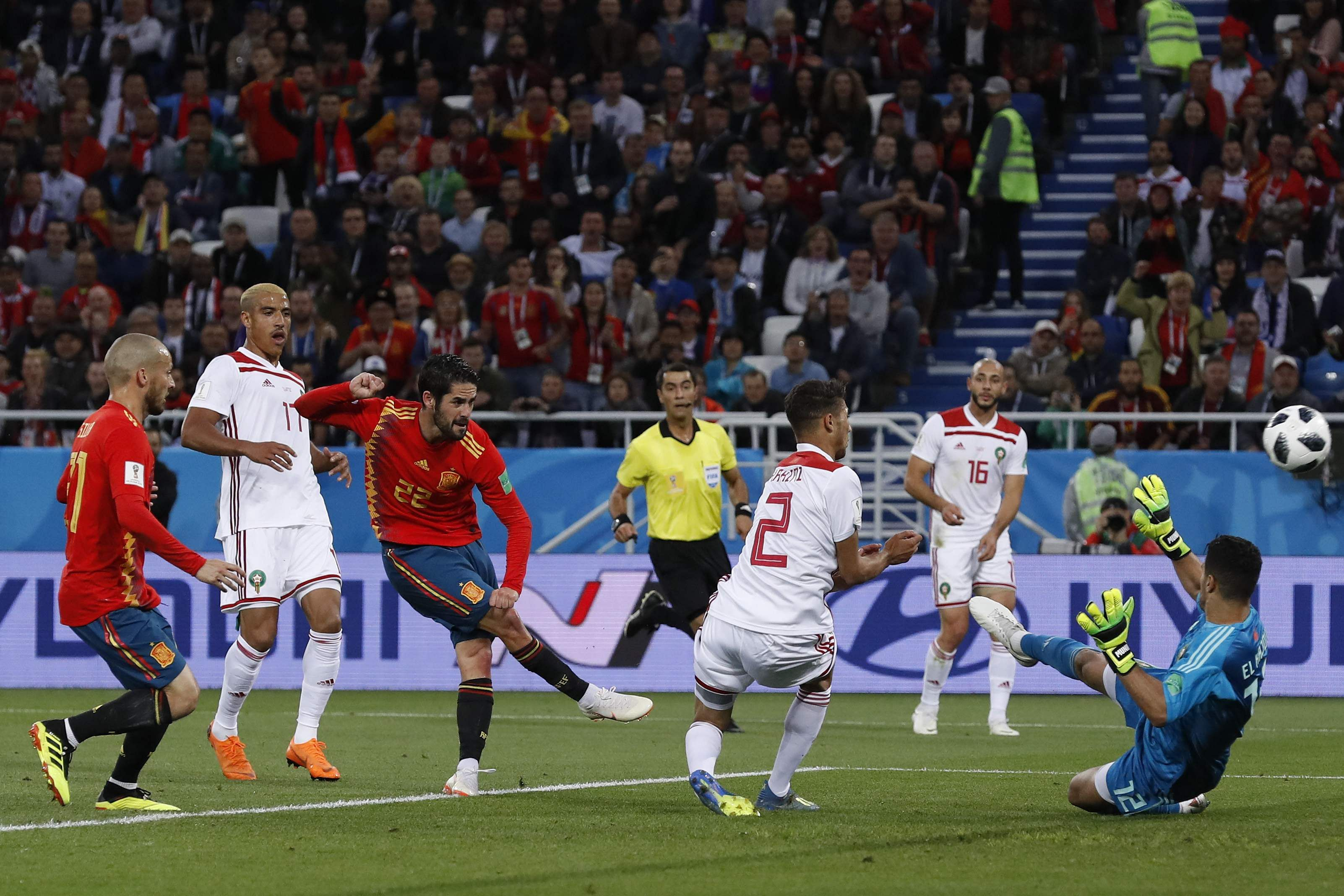 Spain's Isco, third left, scores his side's opening goal during the group B match between Spain and Morocco at the 2018 FIFA World Cup. (Photo | AP)