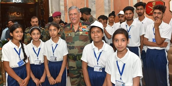 Chief of Army Staff General Bipin Rawat poses with the students from Jammu and Kashmir on National Integration/Educational Tour organised by the Army in New Delhi. (Photo | PTI)