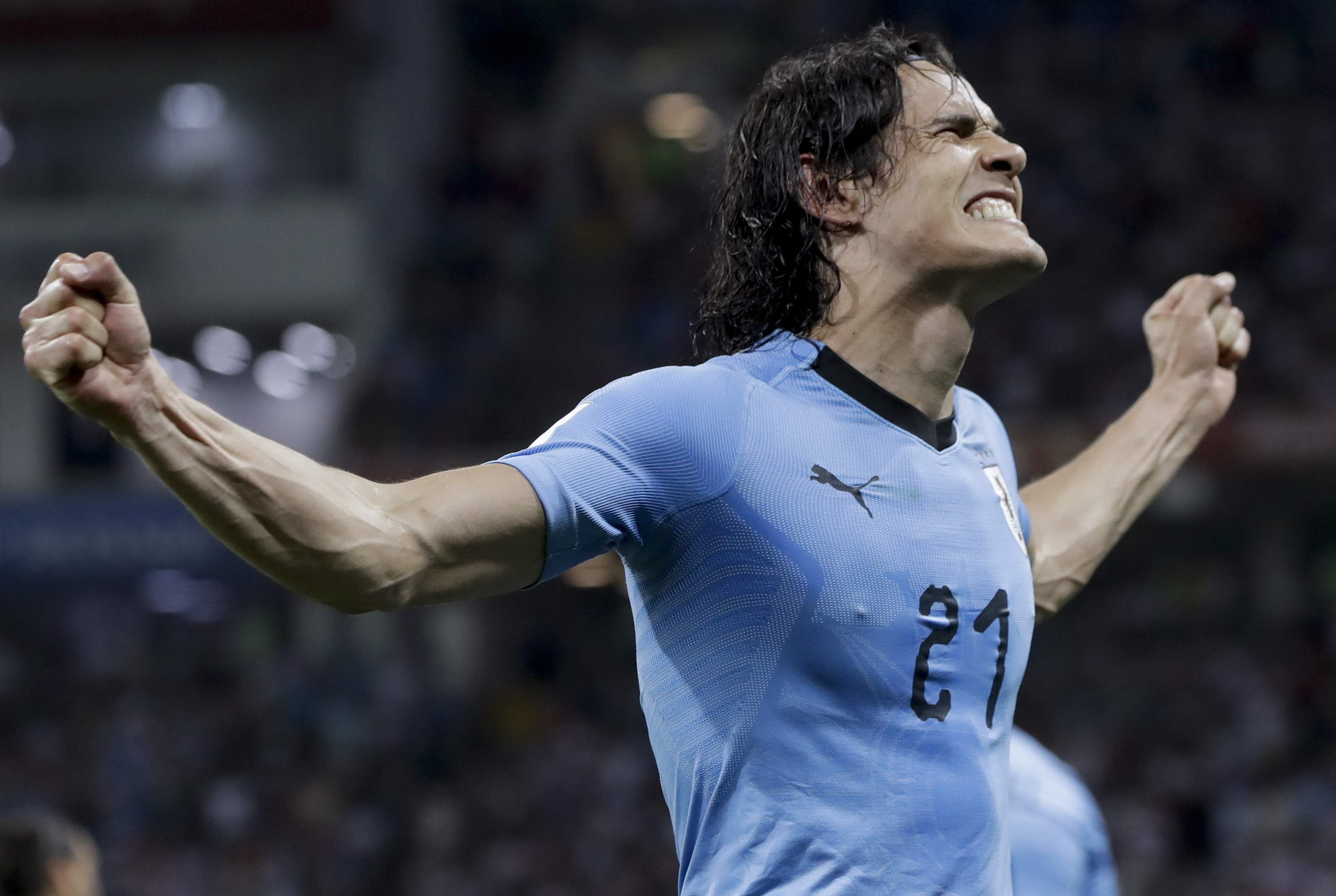 Uruguay's Edinson Cavani celebrates after scoring his side's second goal. (Photo | AP)
