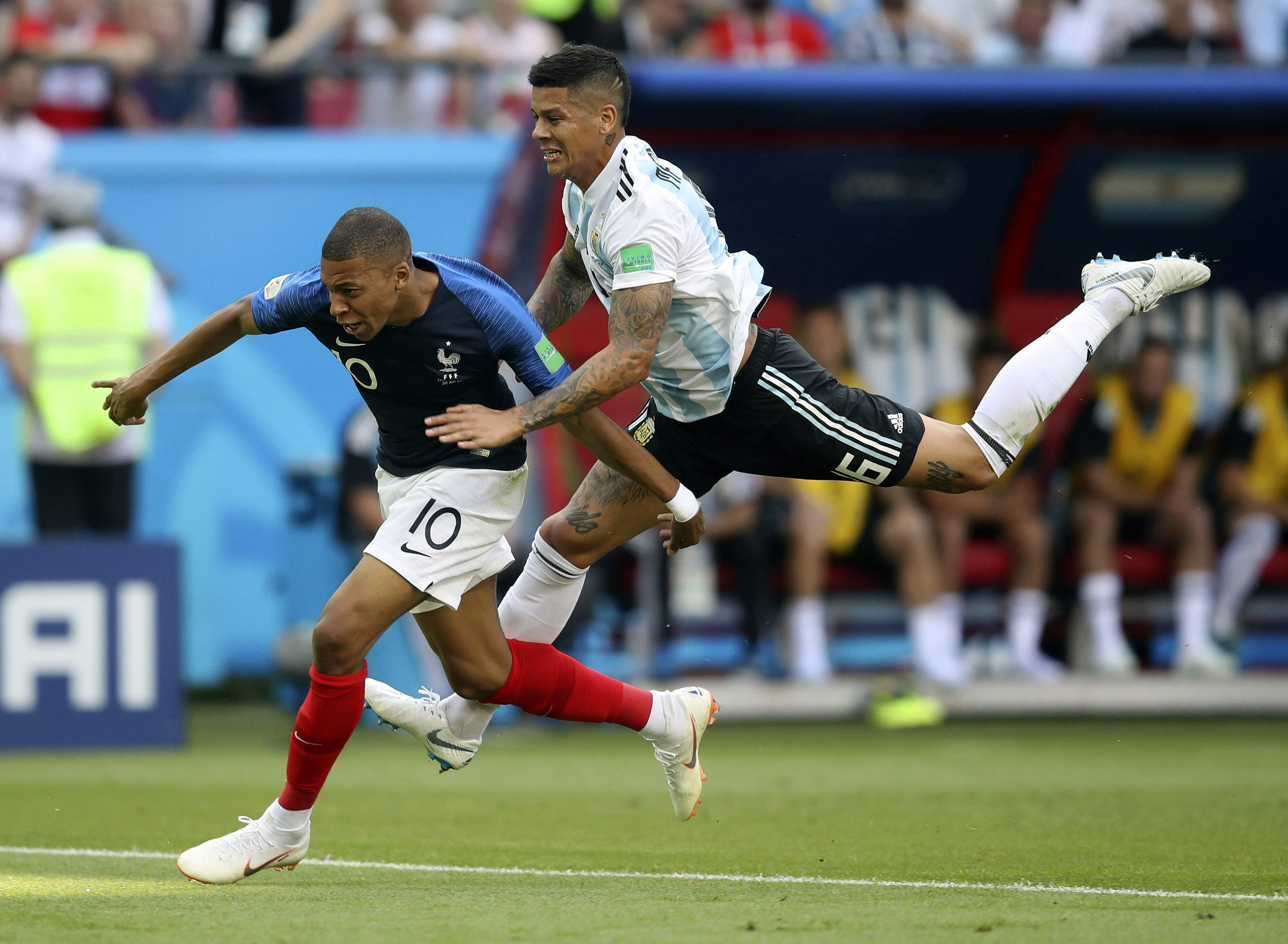 France's Kylian Mbappe, left, is fouled by Argentina's Marcos Rojo, drawing a penalty. (Photo | AP)