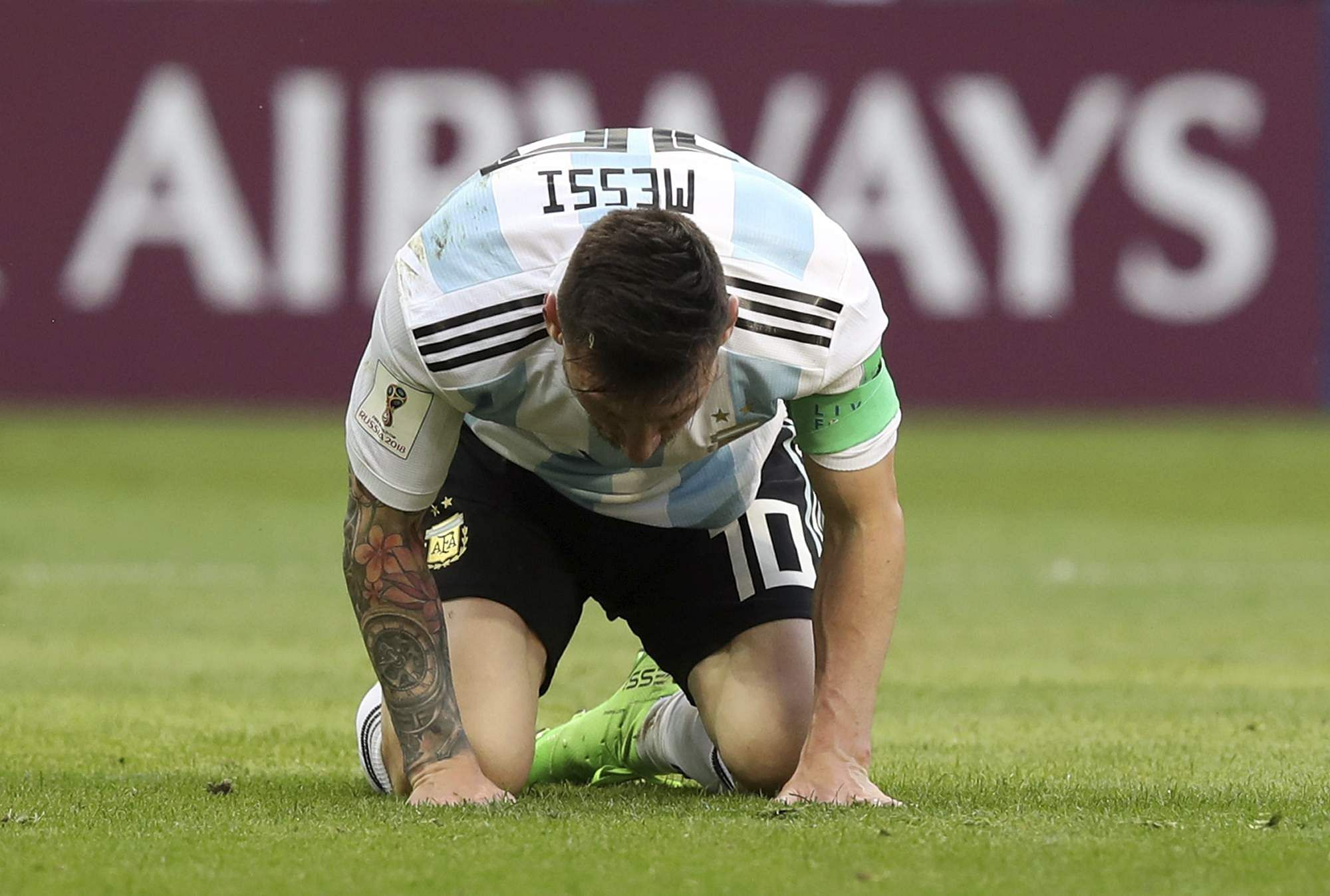 Argentina's Lionel Messi kneels on the pitch, as France's lightning teenager Kylian Mbappe scored two goals to knock Argentina out of FIFA World Cup 2018. (Photo | AP)