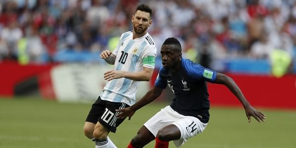 f310001f ... right, challenges for the ball with Argentina's Lionel Messi during the  round of 16 match between France and Argentina, at the 2018 soccer World Cup  at ...