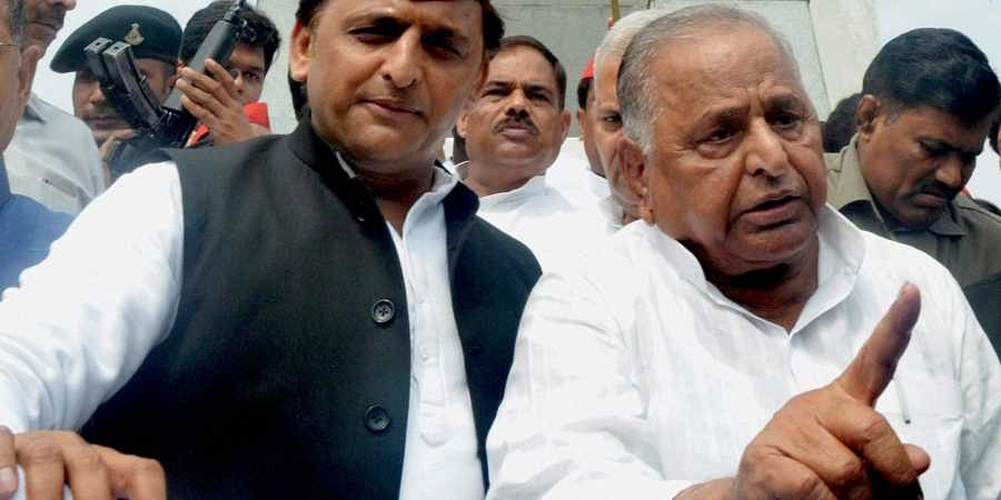 Samajwadi Party founder Mulayam Singh Yadav (R) and party president Akhilesh Yadav (L) after paying tributes to Ram Manohar Lohia on his 50th death anniversary at Lohia Park in Lucknow. | PTI