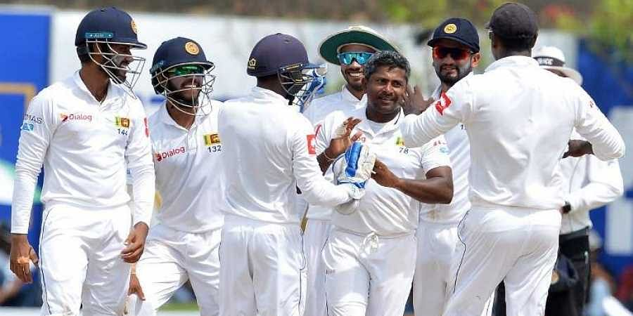 Sri Lanka's Rangana Herath (C) celebrates with his teammates after he dismissed South Africa's Dale Steyn during the third day of the opening Test match between Sri Lanka and South Africa at the Galle International Cricket Stadium in Galle. (Photo | AFP)