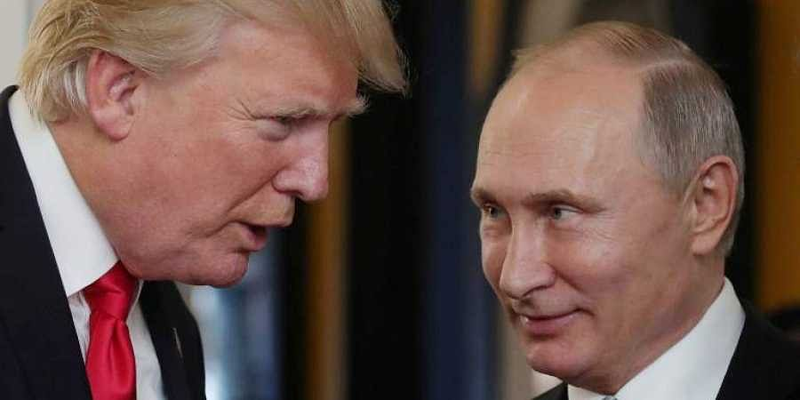 In this file photo taken on November 11, 2017 US President Donald Trump (L) chats with Russia's President Vladimir Putin. (File | AFP)