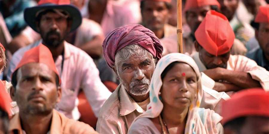 Maharashtra farmers look on as they assemble in Mumbai as part of the 'Kisan Long March' for proper implementation of the Maharashtra government's loan waiver scheme. (Photo: PTI)