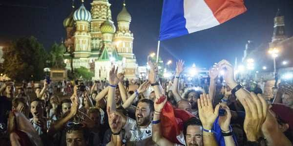 France's soccer fans celebrate in Red square, with the St. Basil's Cathedral in the background, after their team won the final match between France and Croatia. (AP)